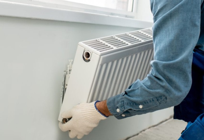 Central Heating Grants - installing central heating radiators